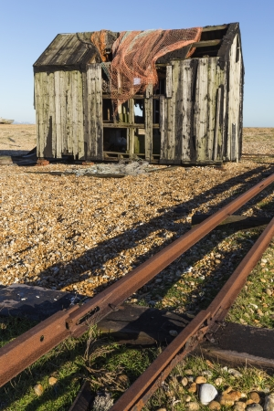 dungeness: Old Fishing Hut and Net on Dungeness Beach UK