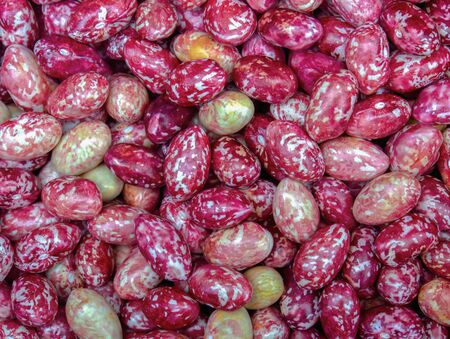 Macro photography of a heap of borlotti beans. Captured at the local traditional market of the colonial town of Villa de leyva, in the Andean mountains of central Colombia.