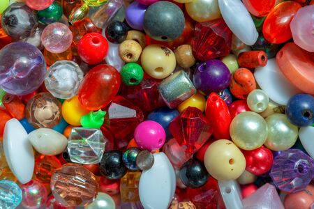 Macro photography of some colorful beads of different shape used for manufacturing jewerly and accesories.