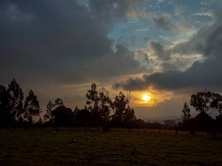 Sunset in the farmlands of the highlands of the central Andean mountains of Colombia
