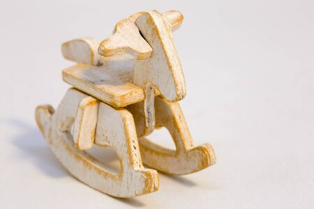 Macro photography of an assembled wooden rocking horse miniature toy. Фото со стока