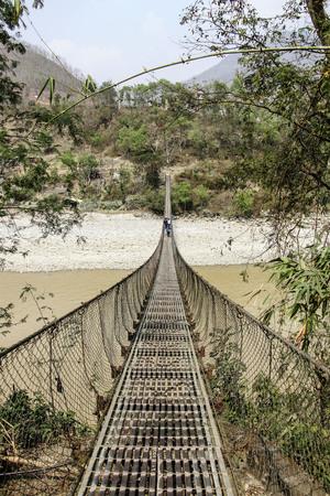 suspension bridge Himalayas Nepal Stock Photo