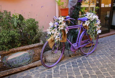 Colorful painted bicycle decorated with flowers Stock Photo