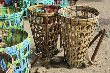 Wicker baskets for carrying weights. The traditional way of carrying weights in Myanmar (Burma)