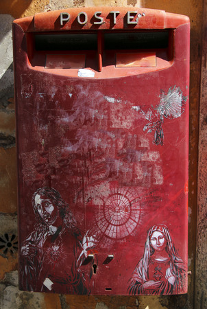Beautiful traditional mailbox red colors, Rome, Italy.Text is translated in English: mail