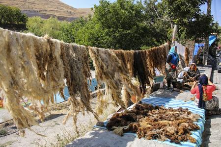 KANDOVAN, IRAN - SEPTEMBER 27, 2018: Local Iranian women process camel wool in rock village Kandovan. Iran Editorial