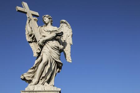 Medieval figure of an angel on the famous bridge Saint Angelo bridge, Rome, Italy