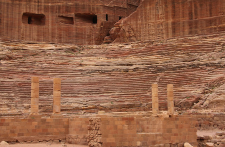 Roman theater in the ancient Arab Nabataean Kingdom city of Petra. Jordan Stock Photo