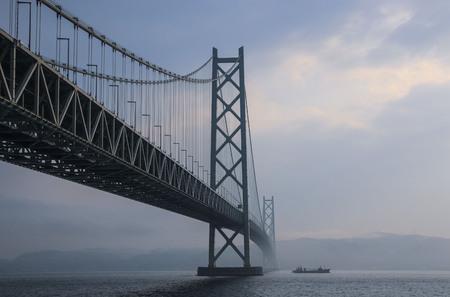 KOBE, JAPAN- MARCH 30, 2019: Akashi Kaikyo Bridge spanning the Seto Inland Sea from Awaji Island to Kobe, Japan.