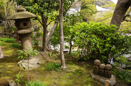 Stone statue of three smiling Jizo (Nagomi Jizo), Hasedera temple, Kamakura, Japan 写真素材