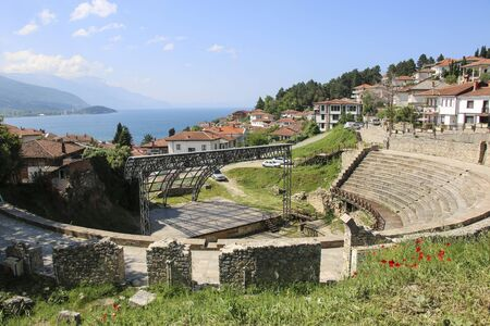 Antique ancient roman amphitheater or antique theatre of Ohrid with view on old town of Ohrid and Lake Ohrid, Republic of North Macedonia