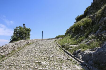 Paved road leading to historic ruins Rozafa Castle in Shkoder, Albania