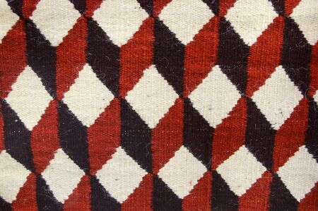 Texture traditional wool carpet with geometric pattern, Albania