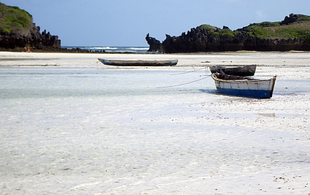 three boats in a beautiful beach of white sand in Kenya photo