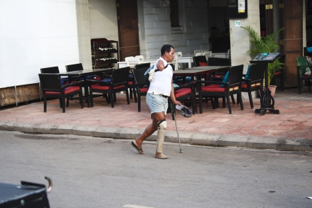 landmine: Siem Reap, Cambodia, April 2013: landmine victim in the pub street of Siem Reap.The country has a major problem with landmines, especially in rural areas. This is the legacy of three decades of war which has taken a severe toll on the Cambodians; it has s