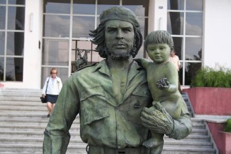 Santa Clara, Cuba - March 29, 2006  statue of Guevara with a child in Santa Clara  This statue was made in 1997 to celebrate the entry of Guevara in Santa Clara on December 28, 1958  Editorial