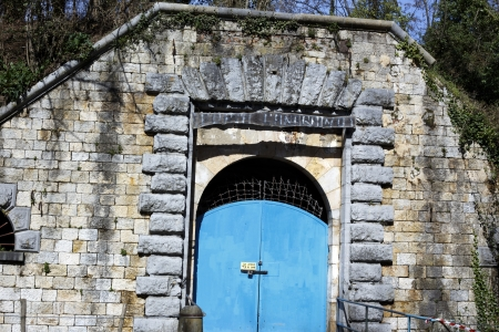 military door of a fortification of the past century photo