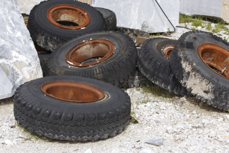 Dumped truck tires and marble Stock Photo