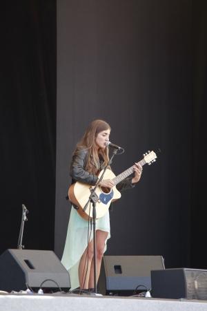 sarzana: Sarzana, Italy - May 26, 2013  Woman playing Acoustic Guitar at Sarzana guitar festival