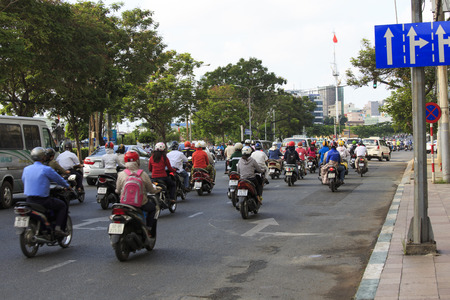 trafic: Ho Chi Minh city, Viet Nam - April 21, 2014: Overview of urban trafic at Asia city, group Asian citizen on private vehicle in trafic jam, crowded, overloaded, mob of people move slow, Vietnam, April 21, 2014 Editorial
