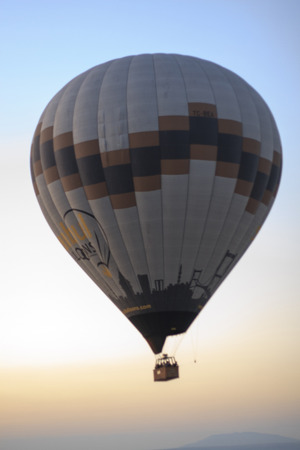 """dozens: Cappadocia, Turkey,€"""" August, 12 2014 : Early morning in Cappadocia, Turkey, dozens of hot air balloons offer guests from all over the world spectacular and breathtaking views of the Cappadocian lunar like landscape. Experienced balloon pilots ascends a"""