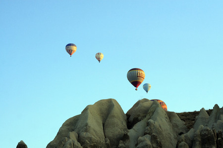"""ascends: Cappadocia, Turkey,"""" August, 12 2014 : Early morning in Cappadocia, Turkey, dozens of hot air balloons offer guests from all over the world spectacular and breathtaking views of the Cappadocian lunar like landscape. Experienced balloon pilots ascends and"""