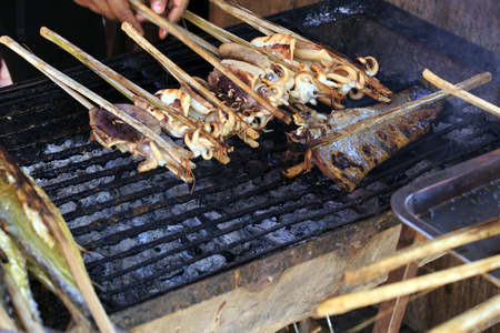 coal fish: Traditional Cambodian style of cooking fish grill Stock Photo