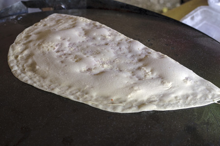 doughy: Gozleme is a kind of pancake or waffle or crepe.It is a pasty that cooking like a pancake.It is a salty dough.