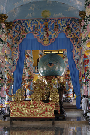 judaism: Tay Ninh, Vietnam - April 22, 2014: People praying in a Caodai temple in Vietnam. Caodai is a Vietnamese religion mixing different religions from around the world, including Buddhism, Confucianism, Christianity, Hinduism, Islam, Judaism, Taoism, and Genii