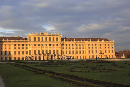 nbrunn: Vienna, Austria - November 2, 2013: People are seen meandering about the gardens behind Schönbrunn Palace, a former imperial 1,441-room Rococo summer residence for members of the Habsburg monarchs.