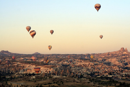 """ascends: Cappadocia, Turkey,"""" August, 12 2014 : Early morning in Cappadocia, Turkey, dozens of hot air balloons offer guests from all over the world spectacular and breathtaking views of the Cappadocian lunar like landscape. Experienced balloon pilots ascends and Editorial"""