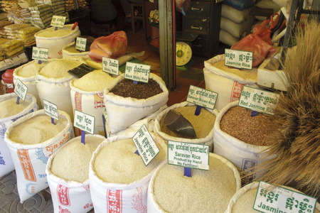 rep: Siem Rep, Cambodia - May 3, 2013: different kinds of rice in big bags close-up in local market in Siem Reap Editorial