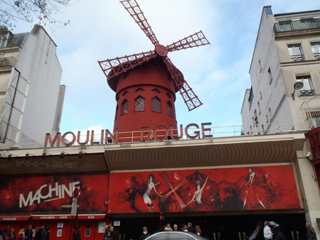 scandalous: PARIS, France - December 15, 2012:  People queue for tickets in front of The Moulin Rouge; famous cabaret and theater on December 15; 2012 in Paris; France