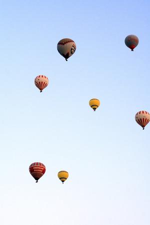 hot air balloons: Nevsehir, Turkey - August 12, 2014. Hot air balloons flying over Cappadocia, Nevsehir, Turkey