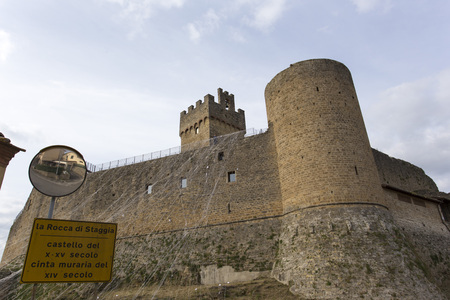 outpost: Staggia, Italy - April 11, 2015: A famous castle in Tuscan, along the medieval road via Francigena
