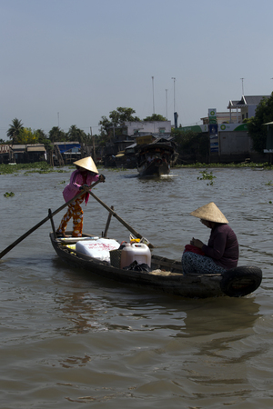 cai: CAI RANG, VIETNAM - APRIL 23: Fresh produce vendors sell from boat to boat at the Cai Rang floating market, Vietnam on April 23, 2014.