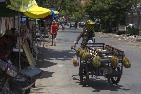 phen: Stock Photo - phnom phen, Cambodia - April 25, 2014: seller at market street in Phnom Phen