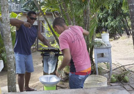 traction engine: Manaca Iznaga, Cuba - January 2, 2016: Valle de Los Ingenios, sugar cane juice preparation by two cuban guys