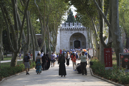 salutation: ISTANBUL, TURKEY - AUGUST 08, 2014 : The Gate of Salutation Topkapi Palace and tourists visiting. Topkapi Palace is the largest and oldest palaces in the world to survive to the present day