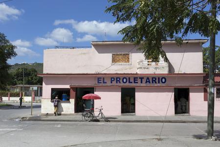 holguin: Camaguay, Cuba - December 28, 2015: Street view in Camaguay, restuarant El Proletario Cuba Editorial