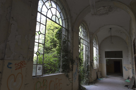 insane insanity: Limbiate, Italy - September 27, 2015: Abandoned Hospital Building called Mombello. The building was abandoned nearly twenty years ago, but never demolished