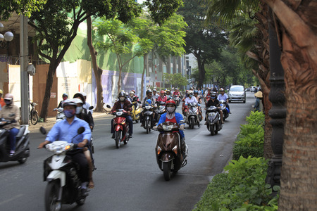 congested: Ho Chi Minh City, Vietnam - February 21, 2014 - A congested road with motorist on Ho Chi Minh street in Vietnam