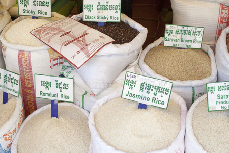 siem: Siem Rep, Cambodia - May 3, 2013: different kinds of rice in big bags close-up in local market in Siem Reap Editorial