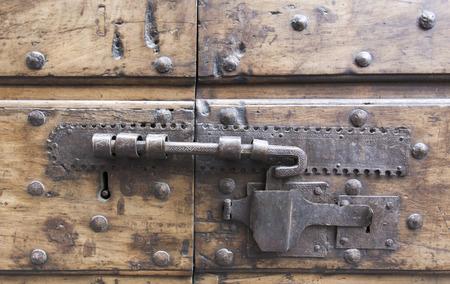 medieval blacksmith: ancient lock in a big wooden door
