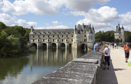Chenonceaux, France - August 09, 2016: Chateau de Chenonceau royal medieval french castle. Castle and garden with walking tourists