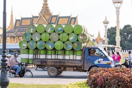 phnom phen, Cambodia - April 25, 2014: barrels transport in Phnom Phen Editorial