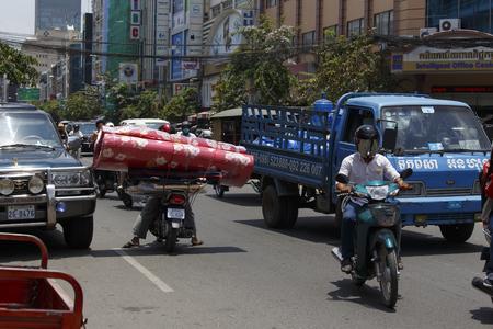 phen: phnom phen, Cambodia - April 25, 2014: crazy transport in Phnom Phen, wrong way