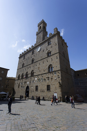 San Gimignano, Italy - April 11, 2015: historic building in san gimignano in tuscany, Italy. Tourists are walking around taking picture