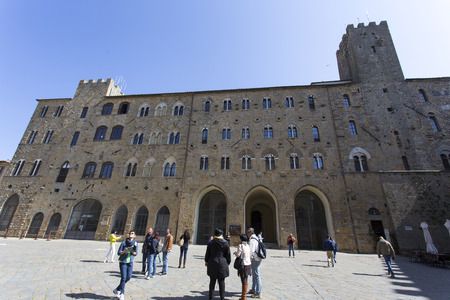San Gimignano, Italy - April 12, 2015: historic building in san gimignano in tuscany, Italy. Tourists are walking around taking picture Editorial