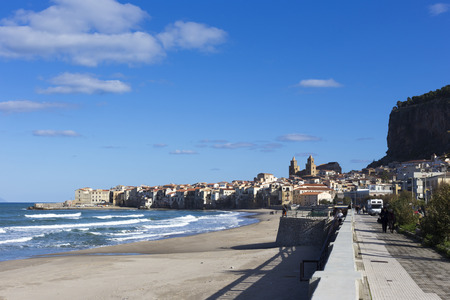 Cefalu, Italy - January 02, 2015: empty beach of Cefalu leading to its old town in a sunny winter day, Sicily Editorial